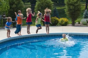 Kids jumping in a pool representing the real estate market