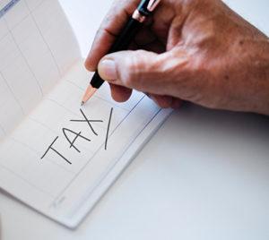 Tax Photo by rawpixel on Unsplash
