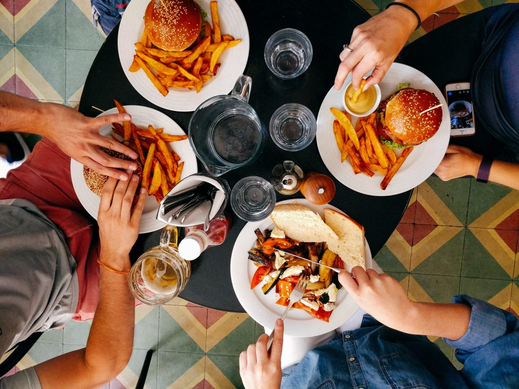 A group of people eating at a restaurant as Summit County loosens Covid restrictions